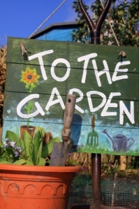 To The Garden Sign With Pot by Simon Howden