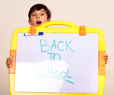 Little Boy Holding a Whiteboard by photostock